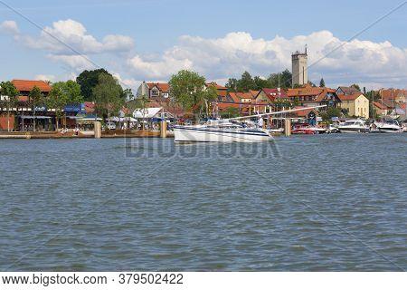 Mikolajki, Masuria, Poland - June 24, 2020: View From Mikolajskie Lake Of Town, Marina For Yachts An