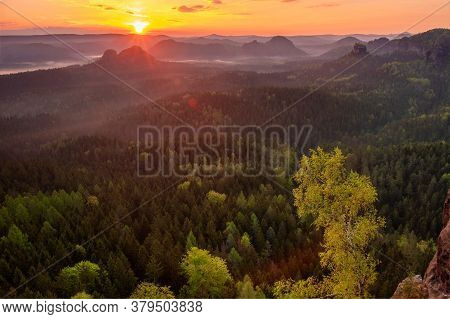 Autumn Sunrise, Saxon Switzerland. Fantastic Colorful Sunrise On The Top Of The Rocky Mountain With