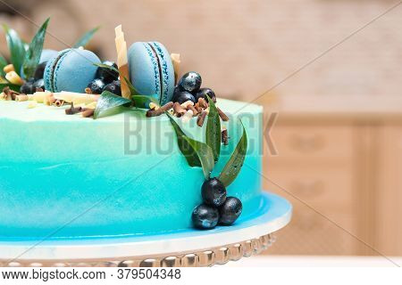 Birthday Cake With French Macaroon And Blueberries. Tasty Fruit Cake On The Table.