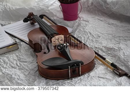 Violin And Bow Put On Background,prepare For Practice,blurry Light Around
