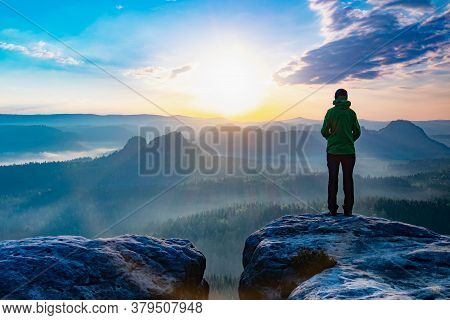 Travel Girl In A Dress Stands On Top Of A Mountain, A Woman Looks At A Mountain Valley. The Girl Tra