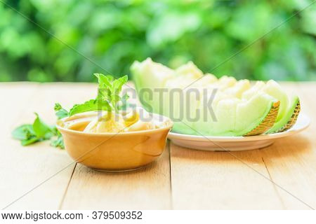 Ice Cream Melon With Green Melon For Eat On Wood Table