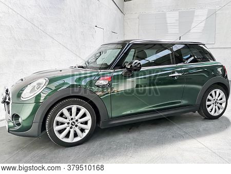 Bordeaux , Aquitaine / France - 07 30 2020 : Mini Car In Racing Green Color Side View In Dealership