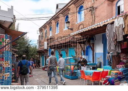 Chefchaouen, Morocco - October 26, 2018: Tourists Exploring The Picturesque Streets Of The Blue City
