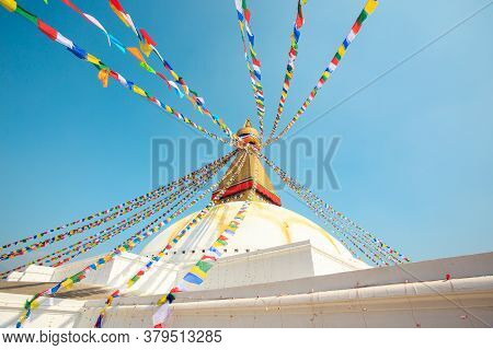 Prayer Buddhist Flags Fluttering In The Wind On The Boudhanath Stupa In Kathmandu, Nepal.
