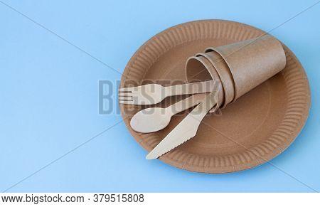 Eco Friendly Disposable Tableware On Light Blue Background With Copy Space