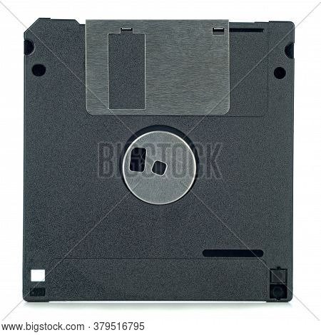 A 3.5 Inch Computer Floppy Disc Viewed From The Back On A White Background