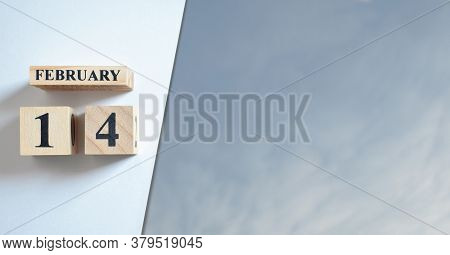 February 14, Number Cube And Blue Sky With Clound.