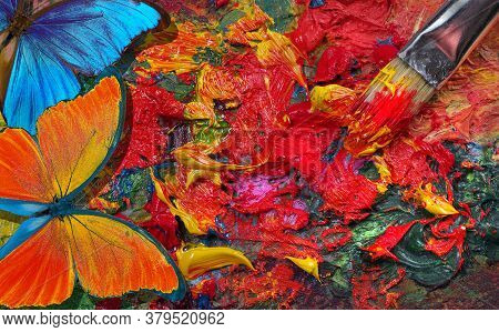 Colorful Tropical Morpho Butterflies On A Artist's Palette. Artist's Palette And Brush Texture Backg
