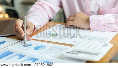 Accounting businessman are calculating income-expenditure and analyzing real estate investment data,