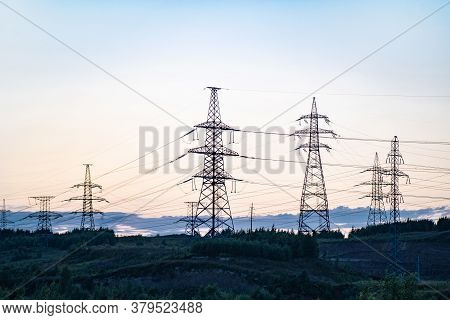 Towers With Insulators On Which The Wires Are Fixed. High-voltage Power Transmission Line. An Extend