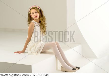 Beautiful Girl Wearing Elegant White Lace Dress Sitting On Stairs, Portrait Of Charming Preteen Girl