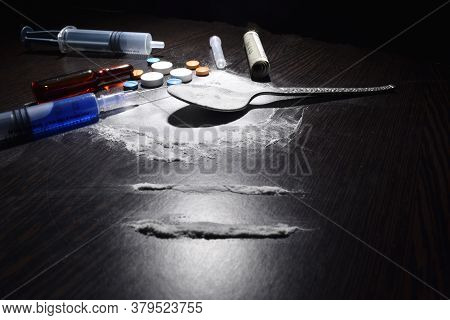 Drugs Concept , Cocaine,injection,table,spoon On Dark Table