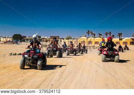 Hurghada, Egypt- Feb 4 , 2020:  Tourists  in safari trip through egyptian desert driving ATV. Quad bikes safari in the desert near Hurghada, Egypt.