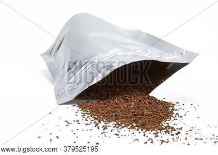 Resealable Aluminum Bag With Brown Beans Coming Out On White Background