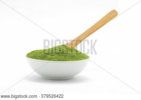 Porcelain White Bowl Wit Matcha Green Tea Texture With Wooden Spoon On White Background