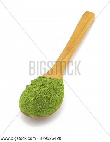A Lot Of Matcha Green Tea In A Spoon On White Background