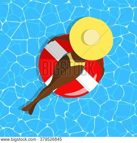 Woman On Swimming Ring Concept. Dark Skinned Girl In A Hat Top View On Blue Water Background. Relaxi