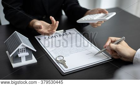 Real estate agent talked about the terms of the home purchase agreement and asked the customer to si
