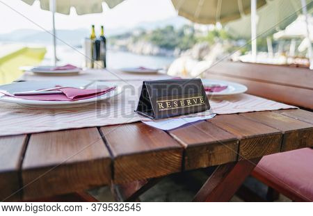 Served Table With Reserved Sign In A Restaurant At The Beach Resort