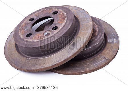 Pair Of Old Brake Discs Covered With Rust On A White Isolated Background In A Photography Studio. Se