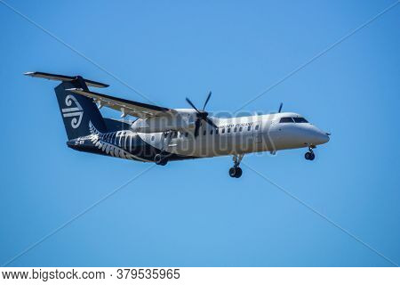 Auckland Airport, New Zealand - February 25, 2020: An Air New Zealand airplane is landing at the Auckland Airport.
