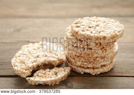 A Stack Of Dietary Round, Airy, Crisp Buckwheat Crispbread On Grey Wooden Background. Top View