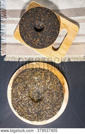 Chinese Tea Shu Shen Puer. Close-up. Pressed Tea. Top View Flat Lay