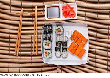 Sushi With Soy Sauce Pickled Ginger, Served On Stone Background. Top View, Flat Lay