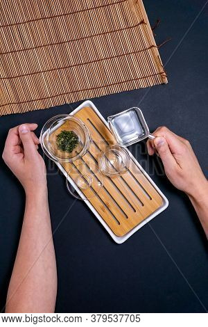 Green Tea For The Ceremony On A Dark Background, Top View, Free Space Vertical Photo Flat Lay