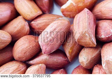 Raw Peanut Grain Close-up Macro Background Texture. Selective Focus