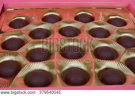 Chocolate Candies In Red Box. Group Of Delicious Chocolate Pralines.
