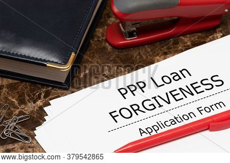 Ppp Loan Forgiveness Text On Application Form Paper. Small Business Payroll Protection Program. Bank