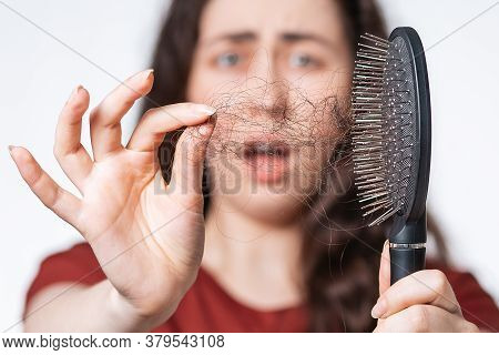 Close Up Portrait In A Blur, A Screaming Brunette Woman Holds A Comb In Front Of Her, Clearing It Fr