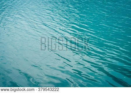 Texture Of Azure Calm Water Of Mountain Lake. Meditative Ripples On Water Surface. Nature Minimal Ba