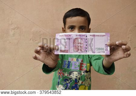 Delhi, India-march 21 2019:cute Little Indian Kid/boy Holding A Fan Of New Indian Paper Currency Not