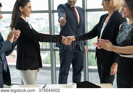 Business People Handshake In Corporate Office Showing Professional Agreement On A Financial Deal Con