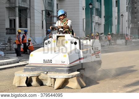 New Delhi, India - August 9, 2015:construction Worker Contractor Man Driving Amphibious Tracked Vehi