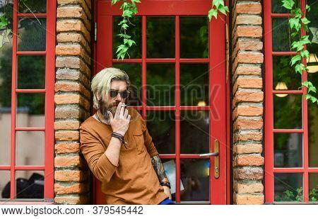 Cool Guy Relaxing. Went On Smoke Break. Hipster Smoking Irish Pub Entrance Background. Smoking Habit