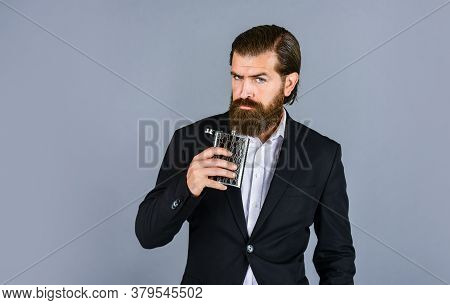 Always With Me. Flat Metal Bottle For Alcohol. Man With Elegant Look. Bearded Hipster In Suit Hold M