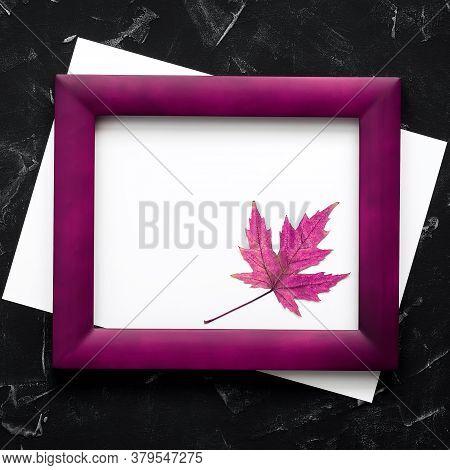 Blank Paper, Maple Leaf, And Wood Frame Mockup Toned Purple. Modern Minimal Composition. Invitation