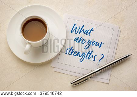 what are your strengths question - handwriting on a napkin with a cup of coffee, career and personal development concept