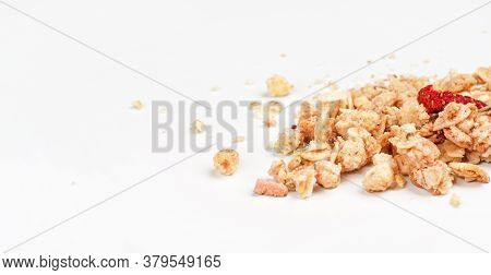 Muesli Flakes With One Dried Strawberry, Closeup Photo Isolated On White Background Space For Text L