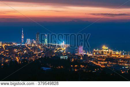 Batumi, Adjara, Georgia. Beautiful Aerial View Of Urban Cityscape At Sunset. Town At Evening Blue Ho