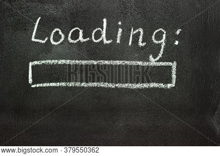 The Loading Process Is Shown In White On A Chalkboard. Stop Motion Animation. Black Background