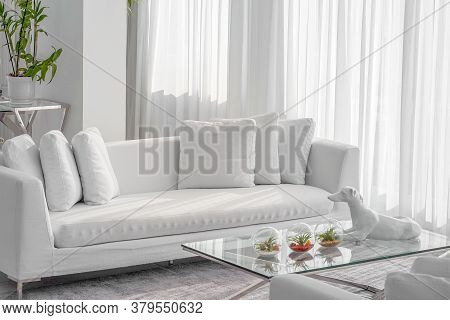 Living Room With White Sofa In Hotel. White Concept Living Room Interior. Modern Sofa In Luxury Vill