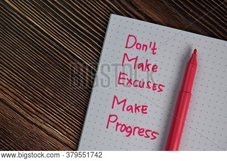Don't Make Excuses Make Progress Write On A Book Isolated Wooden Table.