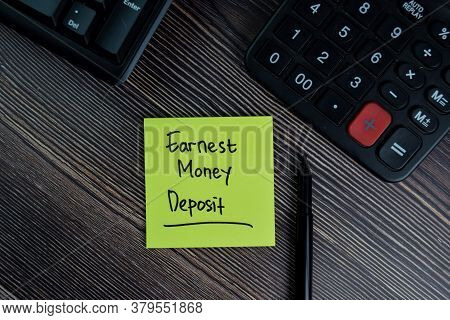 Earnest Money Deposit Write On Sticky Notes Isolated On Office Desk.