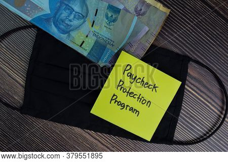 Paycheck Protection Program Write On Sticky Notes Isolated On Office Desk.