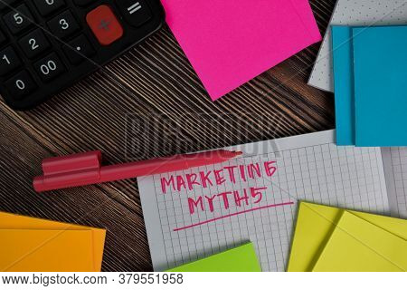 Marketing Myths Write On A Book Isolated Wooden Table.